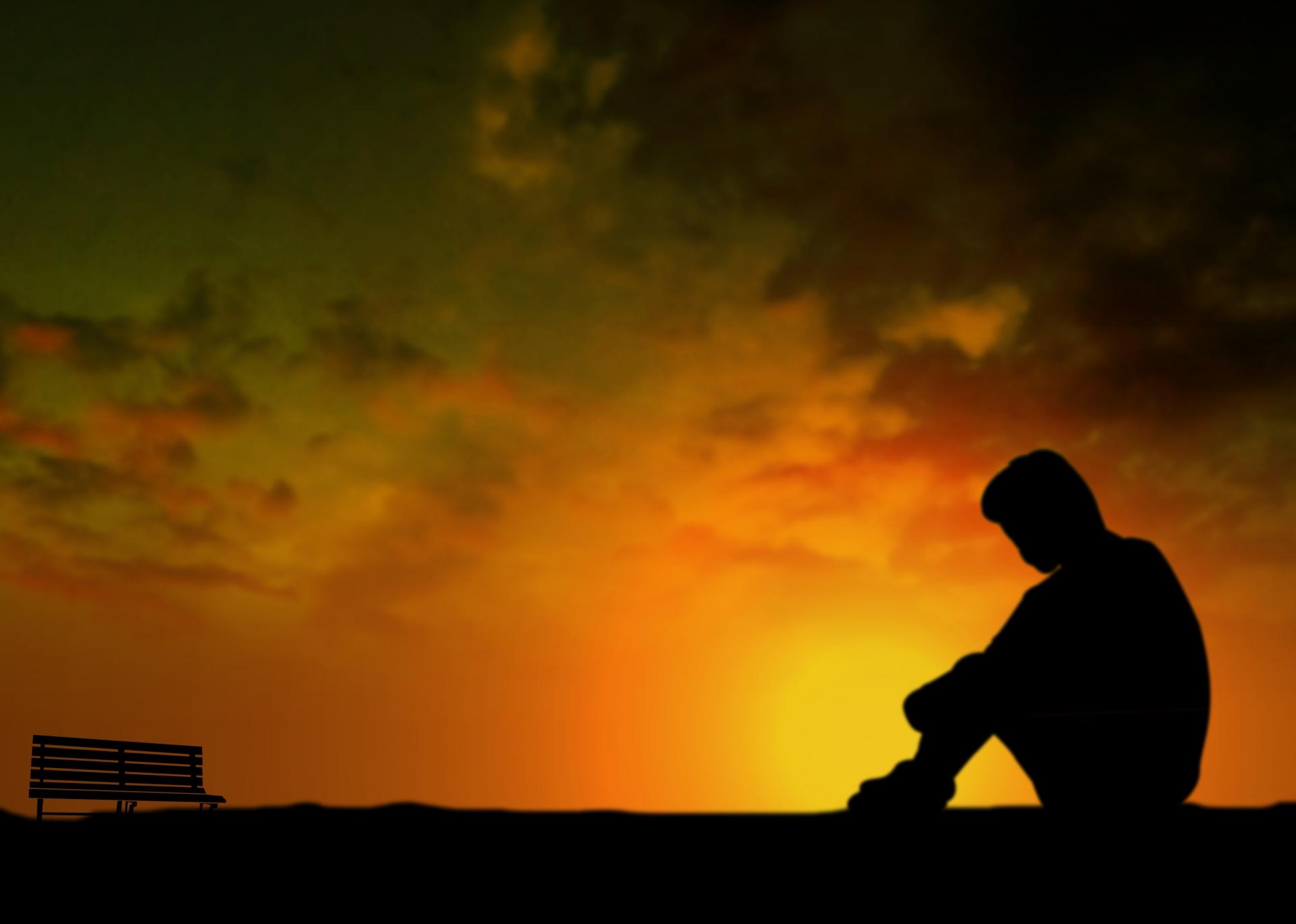 夕陽と一人の男性